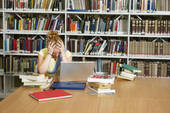 Frustrated Woman In Library